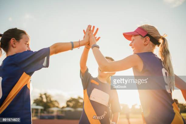 team celebration in athletics club - sports league stock pictures, royalty-free photos & images