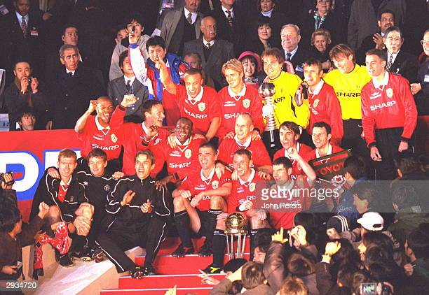 Team celebrations on the pitch after Manchester United were presented with the InterContinental Cup after the InterContinental Cup match between...