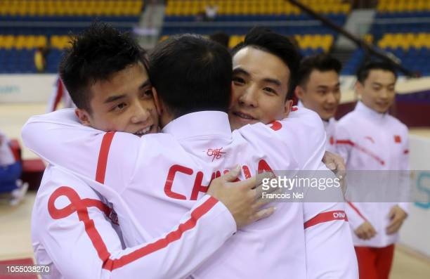 Team China celebrate after their team win the Men's Team Final during day 5 of the 2018 FIG Artistic Gymnastics Championships at Aspire Dome on...