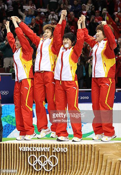 Team China celebrate winning the gold medal in the Short Track Speed Skating Ladies' 3000m relay finals on day 13 of the 2010 Vancouver Winter...