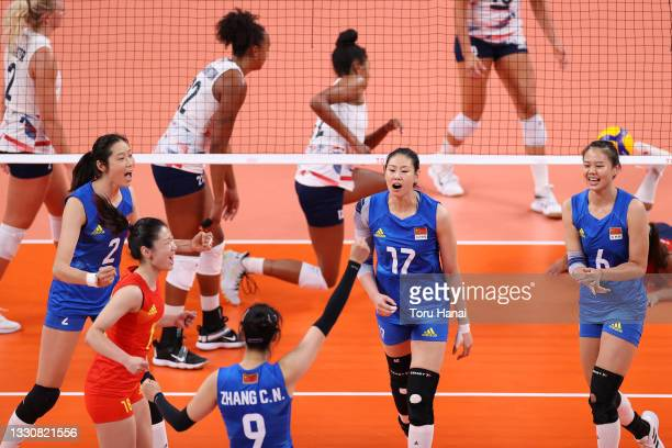 Team China celebrates against Team United States after a point during the Women's Preliminary - Pool B volleyball on day four of the Tokyo 2020...