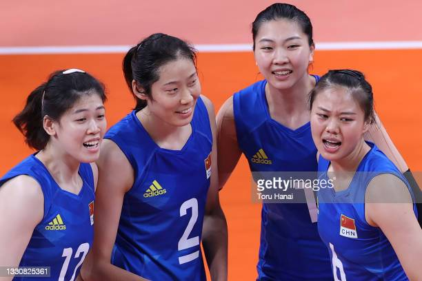 Team China celebrates against Team United States during the Women's Preliminary - Pool B volleyball on day four of the Tokyo 2020 Olympic Games at...