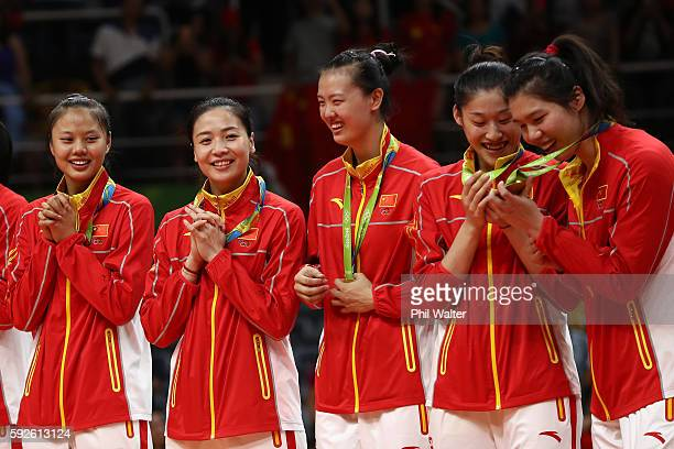 Team China celebrates on the podium after winning gold during the Women's Gold Medal Match between Serbia and China on Day 15 of the Rio 2016 Olympic...