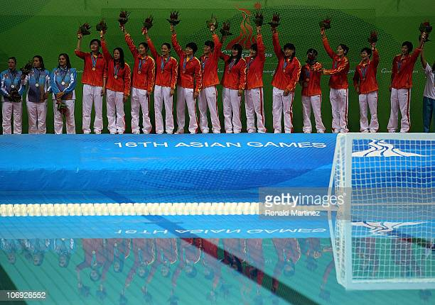Team China celebrates their gold medal win in the Women's Water Polo during day five of the 16th Asian Games Guangzhou 2010 at Tianhe Natatorium on...