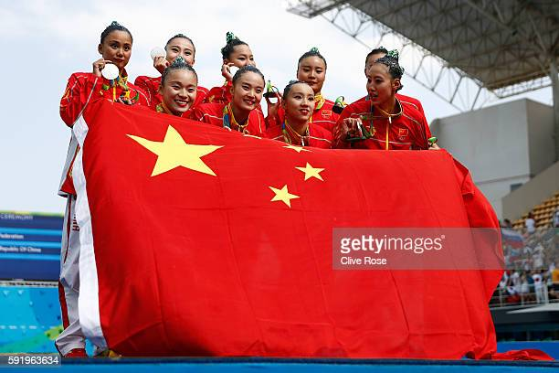 Team China celebrates winning silver on the podium during the medal ceremony for the Synchronised Swimming Teams Free Routine on Day 14 of the Rio...