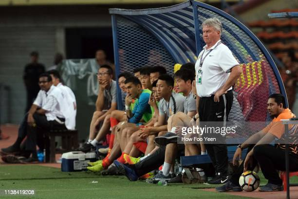 Team China head coach Guus Hiddink watches during the AFC U-23 Championship qualifier between Malaysia and China at Shah Alam Stadium on March 26,...