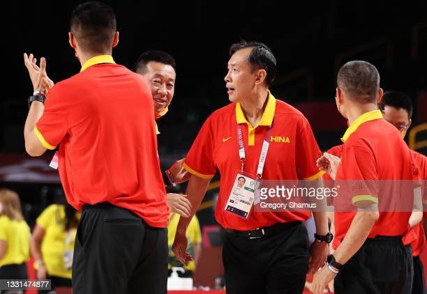 Team China Head Coach Xu Limin celebrates with his coaching staff after his team's victory over Australia in a Women's Basketball Preliminary Round...