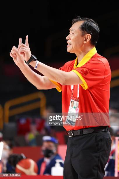 Team China Head Coach Xu Limin signals to his team during the second half of their Women's Basketball Preliminary Round Group C game against...
