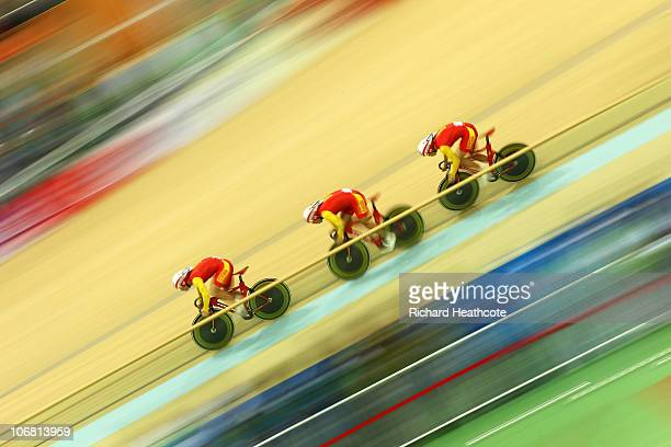 Team China on their way to winning gold in the Men's Team Sprint Final at the Guangzhou Velodrome during day two of the 16th Asian Games Guangzhou...
