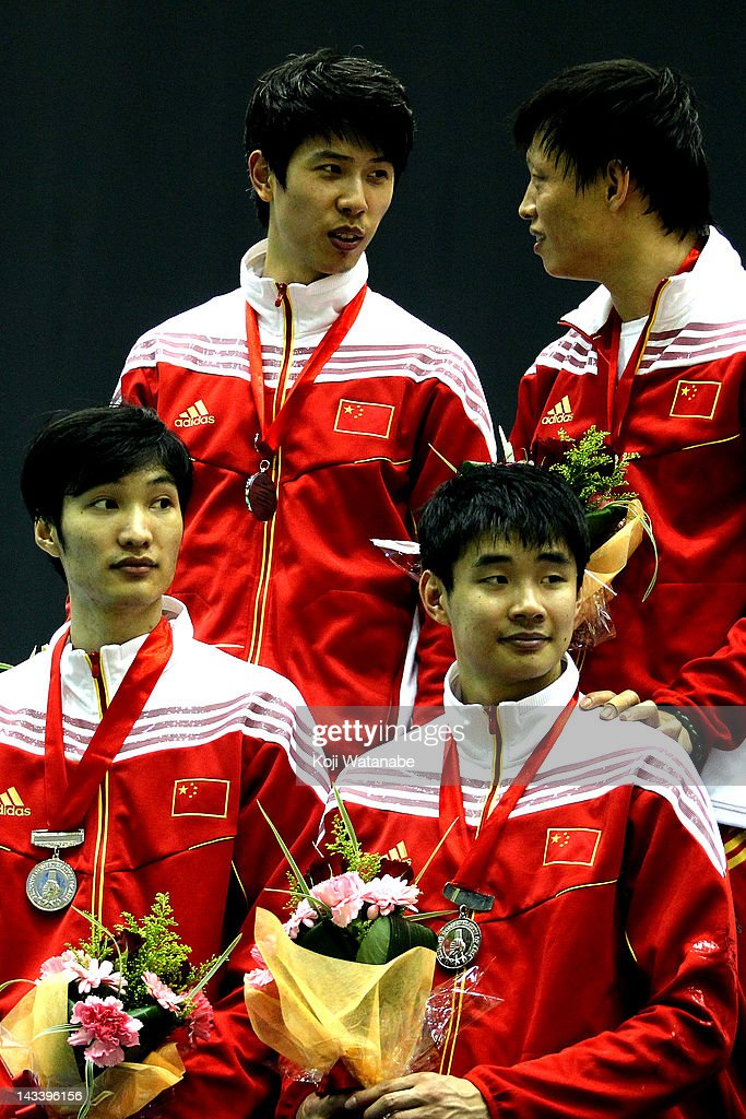 Team China receives the silver medal on the winners podium after in the Men's Foil Team Tableau of final on day four of the 2012 Asian Fencing Championships at Wakayama Big Wave on April 25, 2012 in Wakayama, Japan.