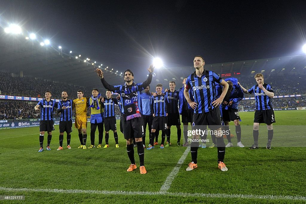 Team Club Brugge with Timmy Simons of Club Brugge and Lior Refaelov of Club Brugge celebrating the victory after the Jupiler Pro League Play-Off 1 match between Club Brugge and Sporting Lokeren on March 28, 2014 in the Jan Breydel Stadium in Brugge, Belgium.