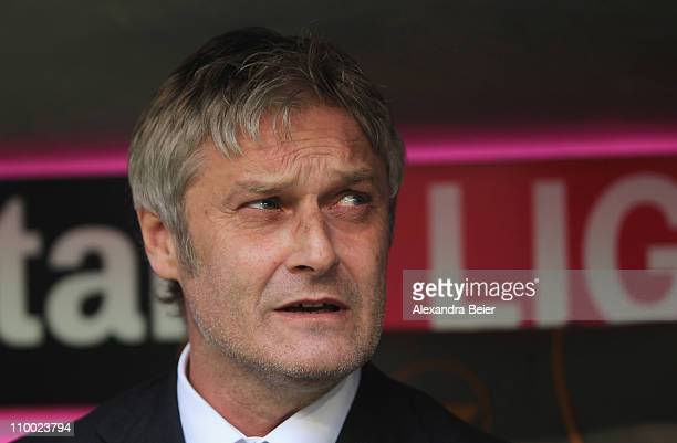 Team coach Armin Veh of Hamburg awaits the start of the Bundesliga match between 1. FC Muenchen and Hamburger SV at Allianz Arena on March 12, 2011...