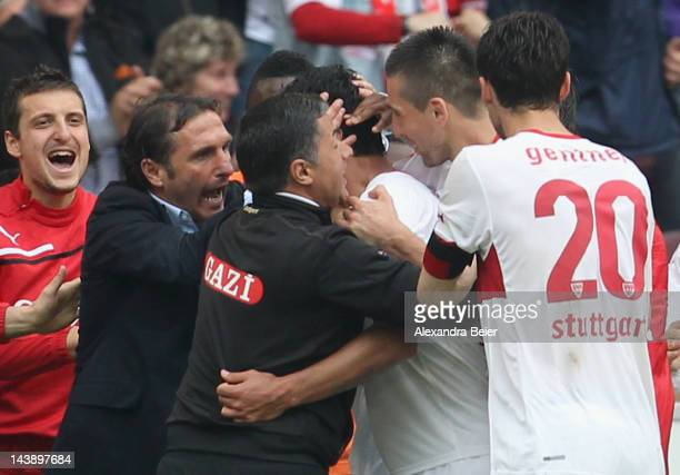 Team coach Bruno Labbadia and his players of Stuttgart celebrate their team's second goal during the Bundesliga match between VfB Stuttgart and VfL...
