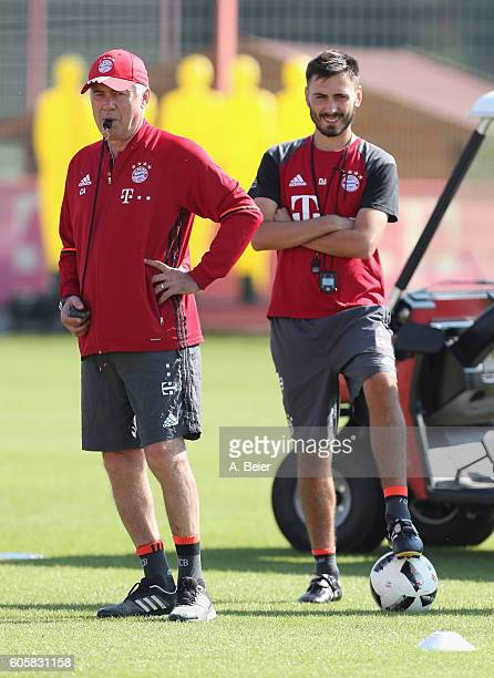 Team coach Carlo Ancelotti and assistent coach Davide Ancelotti of FC Bayern Muenchen are pictured during a training session at the Saebener Strasse...