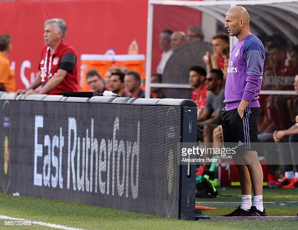 Team coach Carlo Ancelotti of Bayern Muenchen and team coach Zinedine Zidane of Real Madrid are pictured during the International Champions Cup match...
