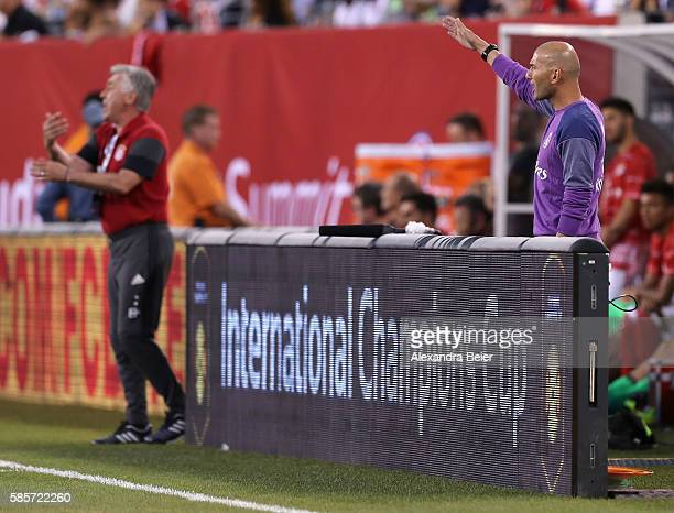 Team coach Carlo Ancelotti of Bayern Muenchen and team coach Zinedine Zidane of Real Madrid react during the International Champions Cup match...