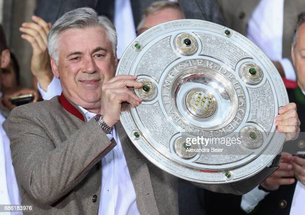 Team coach Carlo Ancelotti of Bayern Muenchen celebrates with teammates and staff winning the 67th German Championship title on the town hall balcony...
