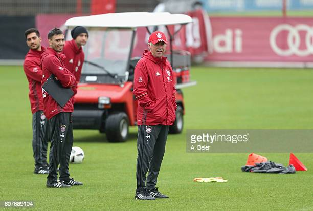 Team coach Carlo Ancelotti of FC Bayern Muenchen and his assistent coaches watch a training session at the Saebener Strasse training ground on...