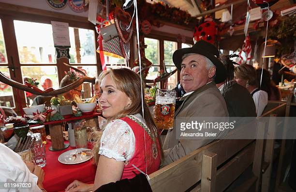 Team coach Carlo Ancelotti of FC Bayern Muenchen and his wife Mariann Barrena McClay attend the Oktoberfest beer festival at Kaefer Wiesenschaenke...