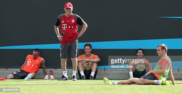 Team coach Carlo Ancelotti of FC Bayern Muenchen is pictured with his players Franck Ribery Nicolas Feldhahn Juan Bernat and Philipp Lahm a training...