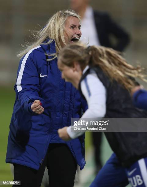 Team coach Emma Hayes of Chelsea FC celebrates her team's victory after the Champions League round of 32 second leg match between FC Bayern Muenchen...