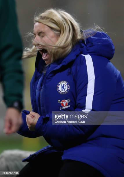 Team coach Emma Hayes of Chelsea FC reacts during her team's first goal during the Champions League round of 32 second leg match between FC Bayern...