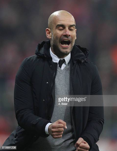Team coach Josep Guardiola of Bayern Muenchen celebrates the team's second goal during the Champions League round of 16 second leg match between FC...