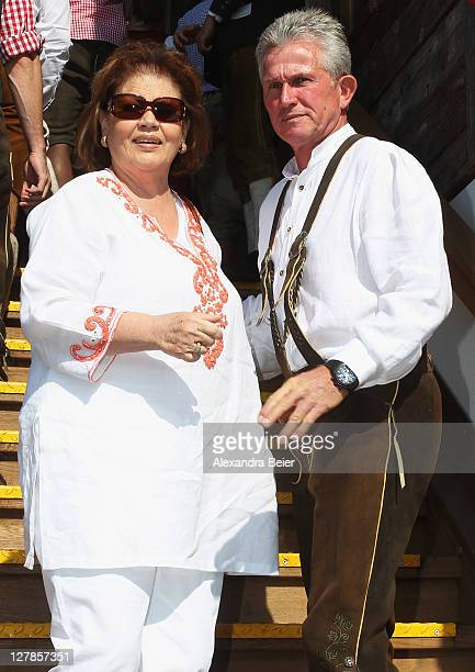 Team coach Jupp Heynckes of FC Bayern Muenchen and his wife Iris arrive for the Oktoberfest beer festival at the Kaefer Wiesnschaenke tent on October...