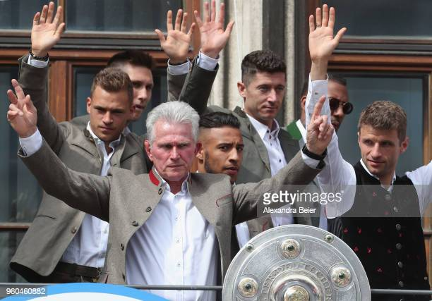 Team coach Jupp Heynckes of FC Bayern Muenchen celebrates winning the German Championship title with his team for the season 2017/18 on the balcony...