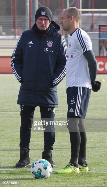 Team coach Jupp Heynckes of FC Bayern Muenchen talks to Arjen Robben during a training session at the club's Saebener Strasse training ground on...