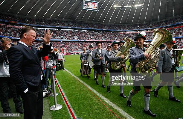 Team coach Louis van Gaal of Muenchen waves to a traditional Bavarian music band before the Bundesliga first league match between FC Bayern Muenchen...