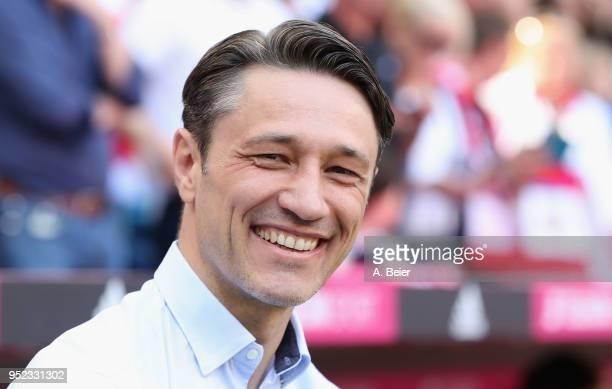 Team coach Niko Kovac of Eintracht Frankfurt smiles before the Bundesliga match between FC Bayern Muenchen and Eintracht Frankfurt at Allianz Arena...