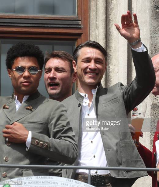 Team coach Niko Kovac of FC Bayern Muenchen assistent coach and brother Robert Kovac and Serge Gnabry are pictured during the celebration of the...