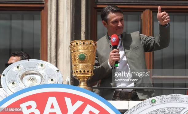 Team coach Niko Kovac of FC Bayern Muenchen gives a thumb up to the fans as he celebrates winning the Bundesliga title and the German Cup title for...