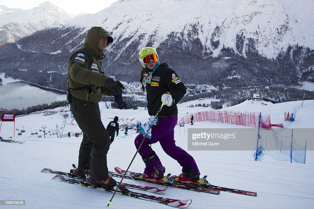 US Team coach Roland Pfeifer briefs Julia Ford of USA before the Audi FIS Alpine Ski World Giant Slalom race on December 9 2012 in St Moritz, Switzerland.