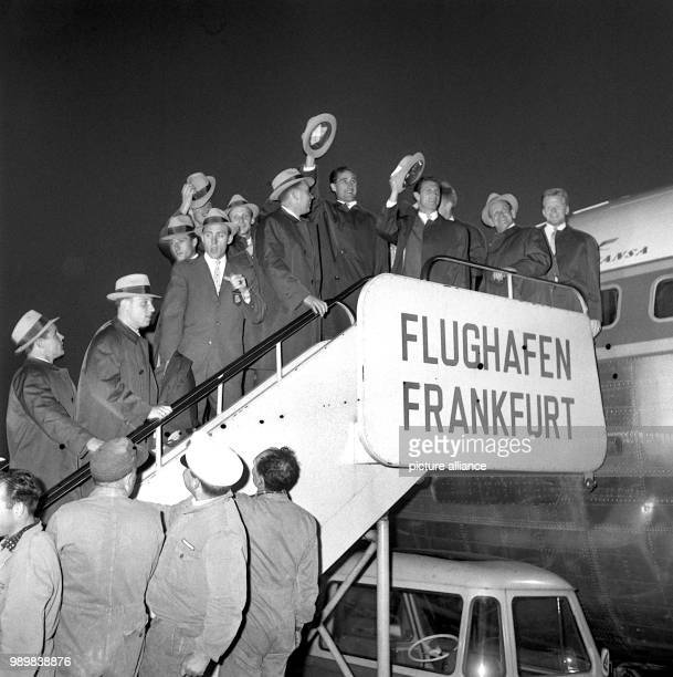 Team coach Sepp Herberger with players and assistants prior to their departure from Frankfurt Airport on their way to the 1962 FIFA World Cup in...
