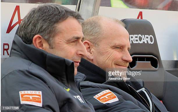 Team coach Thomas Schaaf and manager Klaus Allofs of Bremen smile before the Bundeliga match between 1 FC Nuernberg and SV Werder Bremen at Easy...
