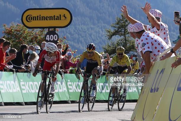 Team Cofidis rider France's Guillaume Martin , Team Jumbo rider Slovenia's Primoz Roglic and Team Deceuninck rider France's Julian Alaphilippe ride...