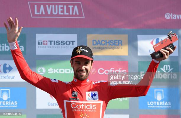 Team Cofidis' Spanish cyclist Jesus Herrada celebrates in the podium retaining the leader's Red Jersey after the 13th stage of the 73rd edition of...