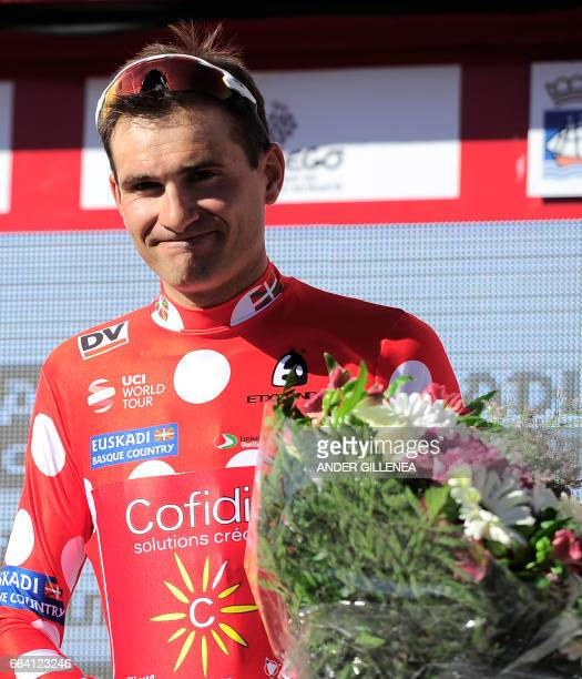 Team Cofidis's French rider Yoann Bagot celebrates after winning the first place on mountain's clasification on the podium of the first stage of the...