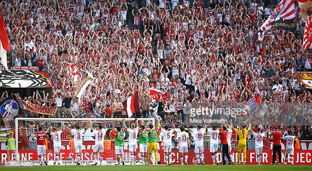 Team Cologne celebrate with fans the good season during the Bundesliga match between 1 FC Koeln and Werder Bremen at RheinEnergieStadion on May 7...