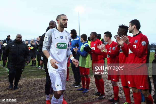 Team Concarneau congratulates team Houilles during the french National Cup match between Houilles and Concarneau on January 6 2018 in Houilles France
