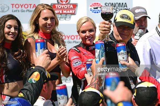 Team co-owner Gene Haas celebrates in victory lane after Tony Stewart, driver of the Code 3 Assoc/Mobil 1 Chevrolet, won the NASCAR Sprint Cup Series...