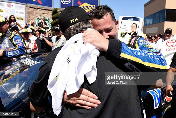 Team co-owner Gene Haas congratulates Tony Stewart, driver of the Code 3 Assoc/Mobil 1 Chevrolet, after winning the NASCAR Sprint Cup Series...