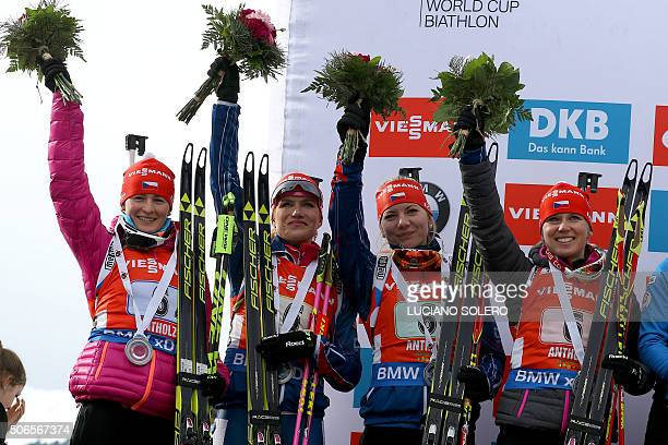 Team Csech Republic placed second with Eva Puskarcikova Lucie Charvatova Gabriela Soukalova Veronica Vitkova celebrate on the podium after the...