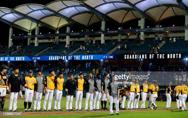 Team CTBC Brothers line up bow to audiences after winning the CPBL game between Fubon Guardians and CTBC Brothers at the Xinzhuang Baseball Stadium...