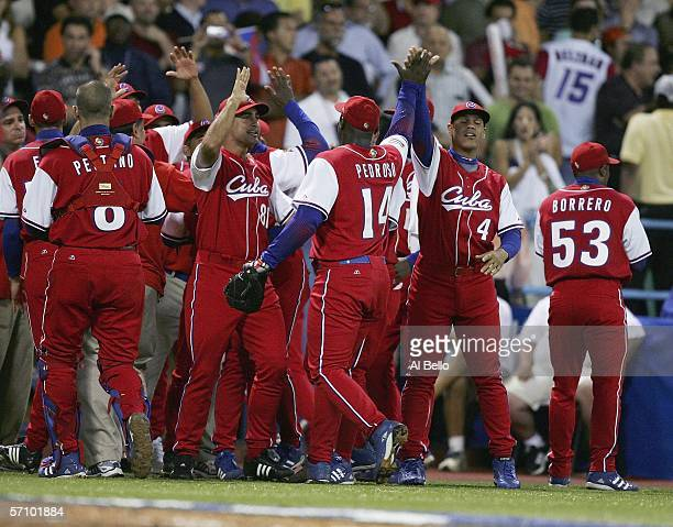 Team Cuba celebrates getting the Puerto Rico side out with two men in scoring position in the eighth inning during Round 2 of the World Baseball...