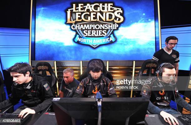 Team Curse players Christian 'IWillDominate' Rivera Joedat 'Voyboy' Esfahani and David 'Cop' Roberson prepare for the start of a match as two...