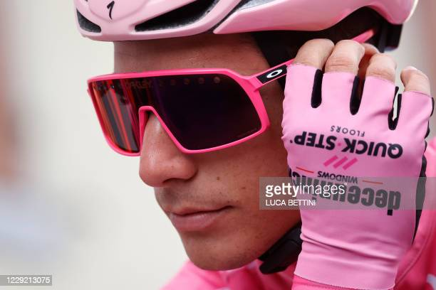 Team Deceuninck Portugal's rider Joao Almeida, wearing the overall Pink Jersey adjusts his googles prior to the start of the 18th stage of the Giro...