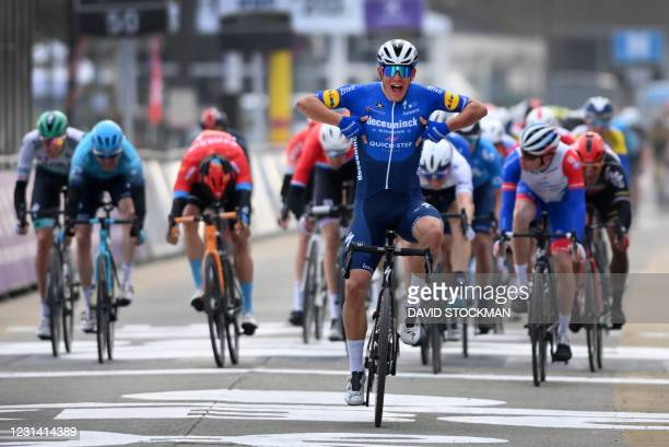 Team Deceuninck - Quick-Step Italian rider Davide Ballerini celebrates as he crosses the finish line to win the World Tour 2021 Omloop Het Nieuwsblad...